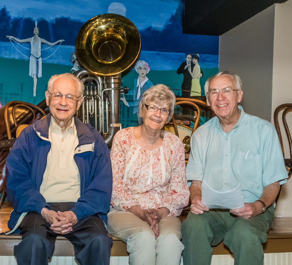 Bix Beiderbecke Museum & Archive organizers (from left) Howard Braren, Geri Bowers, and Carol Schaefer in front of a re-creation of the Hudson Lake stage.