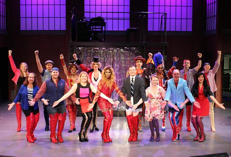 Milak Harris, Michael Penick (both center) and ensemble members in Kinky Boots